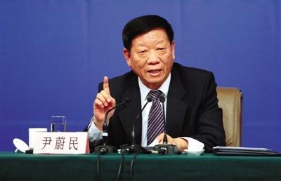 昨日,北京梅地亚中心,十二届全国人大三次会议记者会,尹蔚民回答记者提问。新京报记者 薛珺 摄