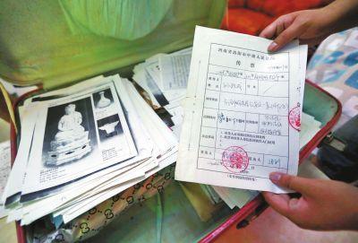 打了10年官司,孙跃成家中的资料装满了一皮箱。