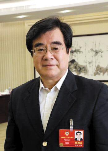 全国政协委员、中国保监会原副主席周延礼。