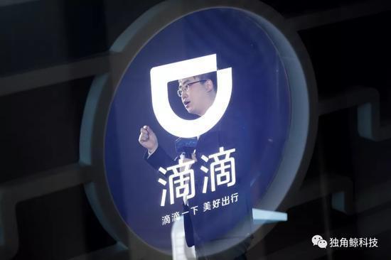 图中人物为程维(使用二次曝光手法拍摄)摄影:新京报记者朱骏