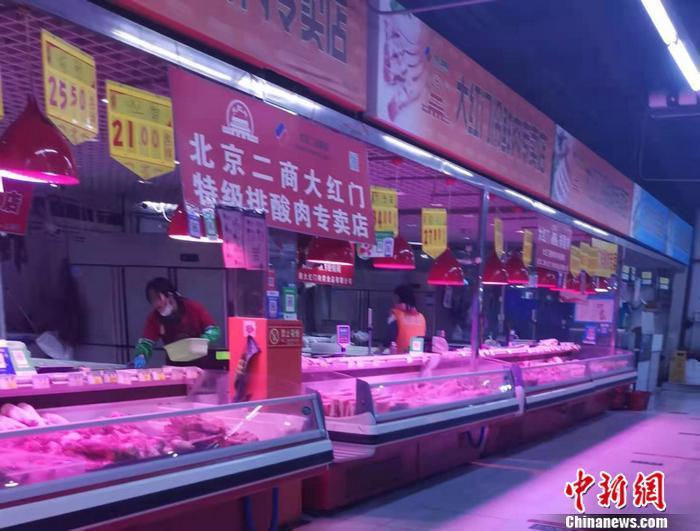 北京豐臺區某菜市場肉類區。